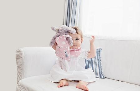 House of Bibs baby girl wearing pink stars cotton dribble bandana bib baby gifts