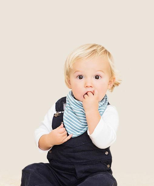 House of Bibs London beautiful cute baby boy wearing reversible organic cotton smoke blue bandana dribble bib impermeable breathable waterproof