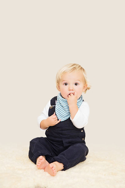 House of Bibs London beautiful cute baby boy wearing reversible organic cotton smoke blue bandana dribble bib impermeable breathable waterproof
