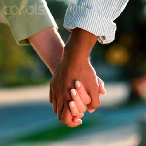 Interracial Couple Holding Hands
