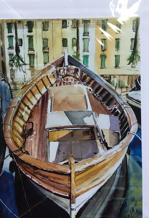 Boat in Bosa Sardinia harbour