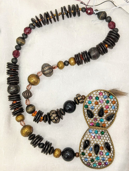 Necklace of beads with a rhinestone clasp