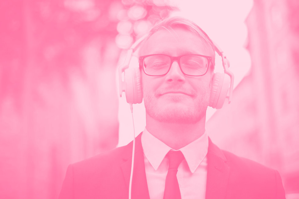 man-wearing-headphones-pexels-andrea-pia