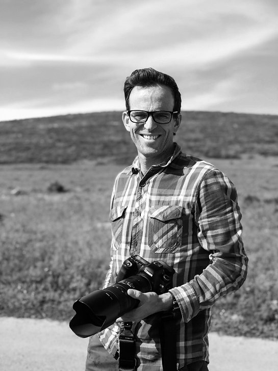 julian-goldswain-smiling-with-camera-in-