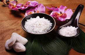 A set of Bath salt on the wooden table.