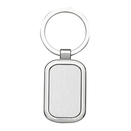 Chaveiro de metal retangular personalizado com bordas arredondadas, possui chapa frontal em metal e verso liso nexo brindes