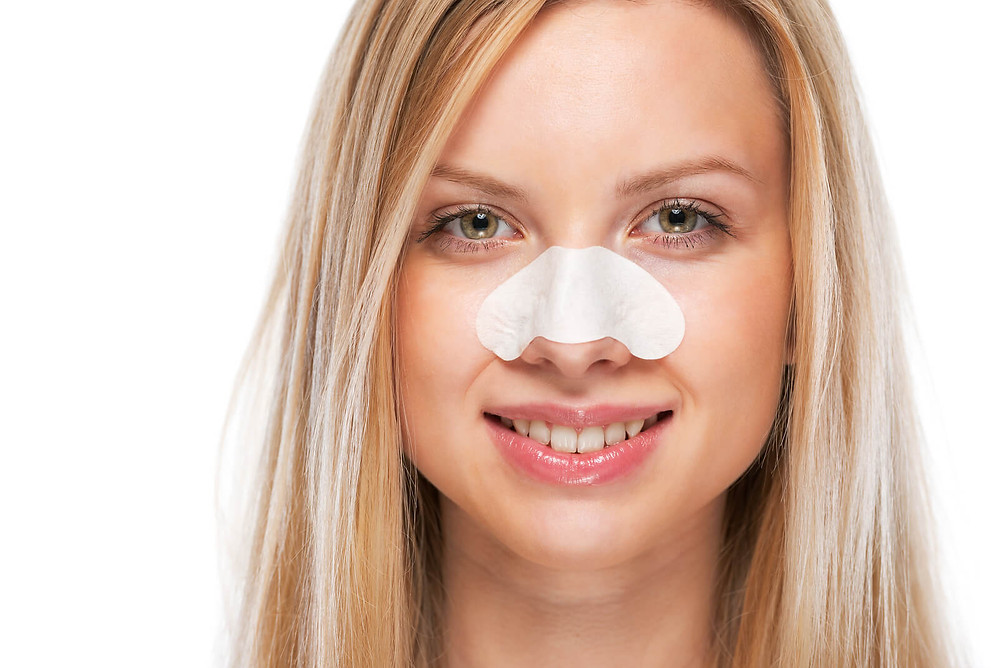 Girl with pore strip