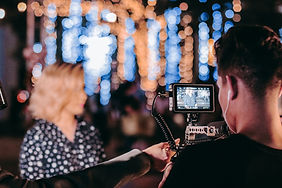 man-in-black-sleeve-shirt-holding-camera