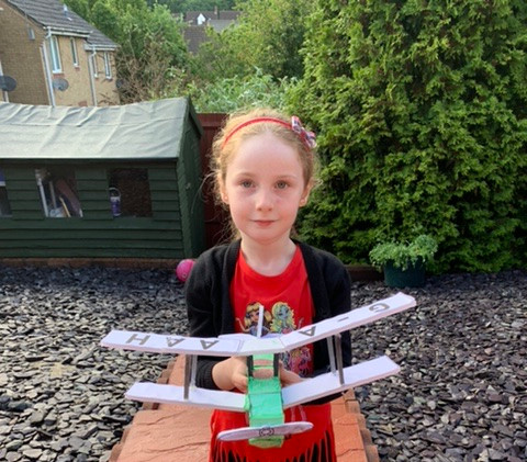 Sofia Sim with her Jason plane