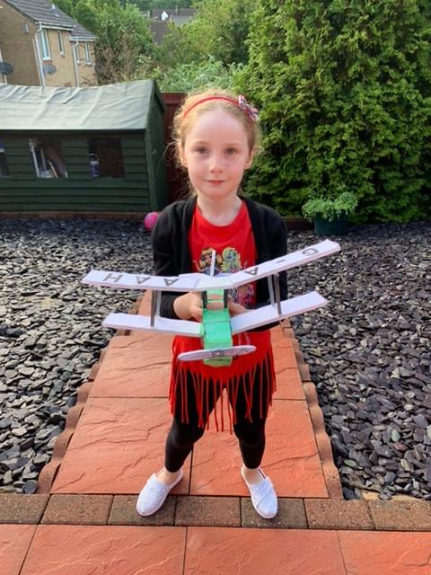 Sofia Sim with her Jason plane