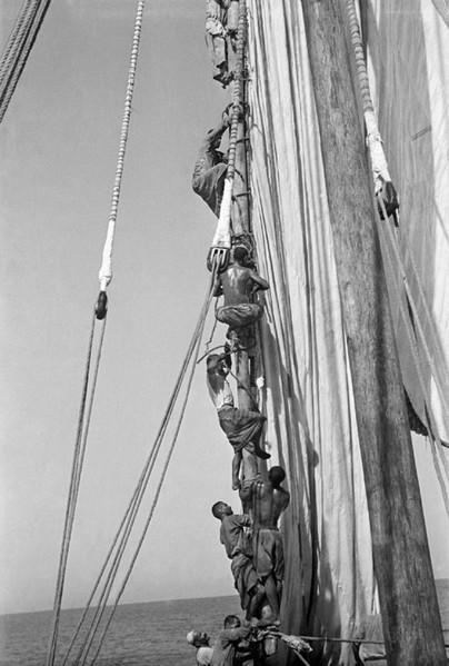 Crew climbing aloft on a mast