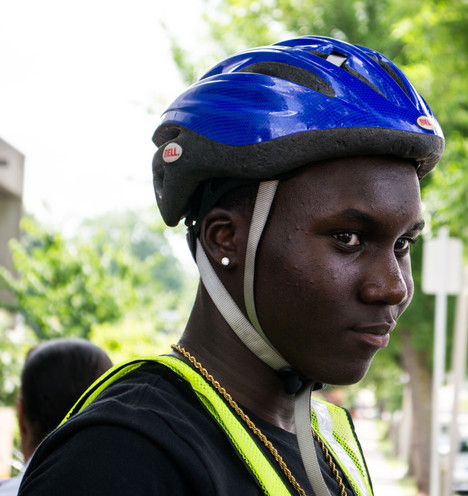 """A youth group in Roxbury, """"Bikes Not Bombs,"""" learns safety as community leaders fight for a protected bike lane."""