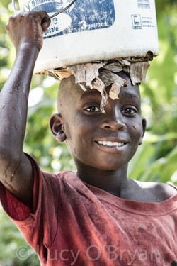 Boy Carries Water