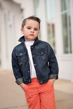 Young boy in a denim jacket