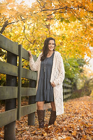 High School Senior girl with country fence and fall leaves