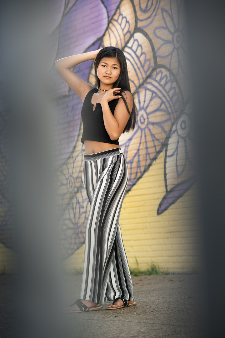 Asian Teen with a mural
