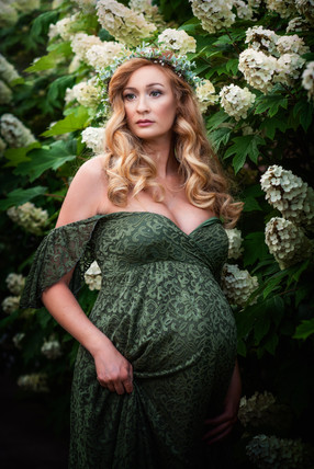 Gorgeous green lace maternity gown from silk fairies. White flowers and red hair_
