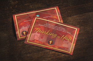 mockup-of-two-postcards-on-a-wooden-surf