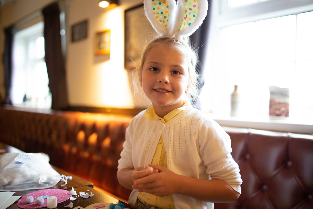 A girl at The Blue Stoops Breakfast with the Easter Bunny event.
