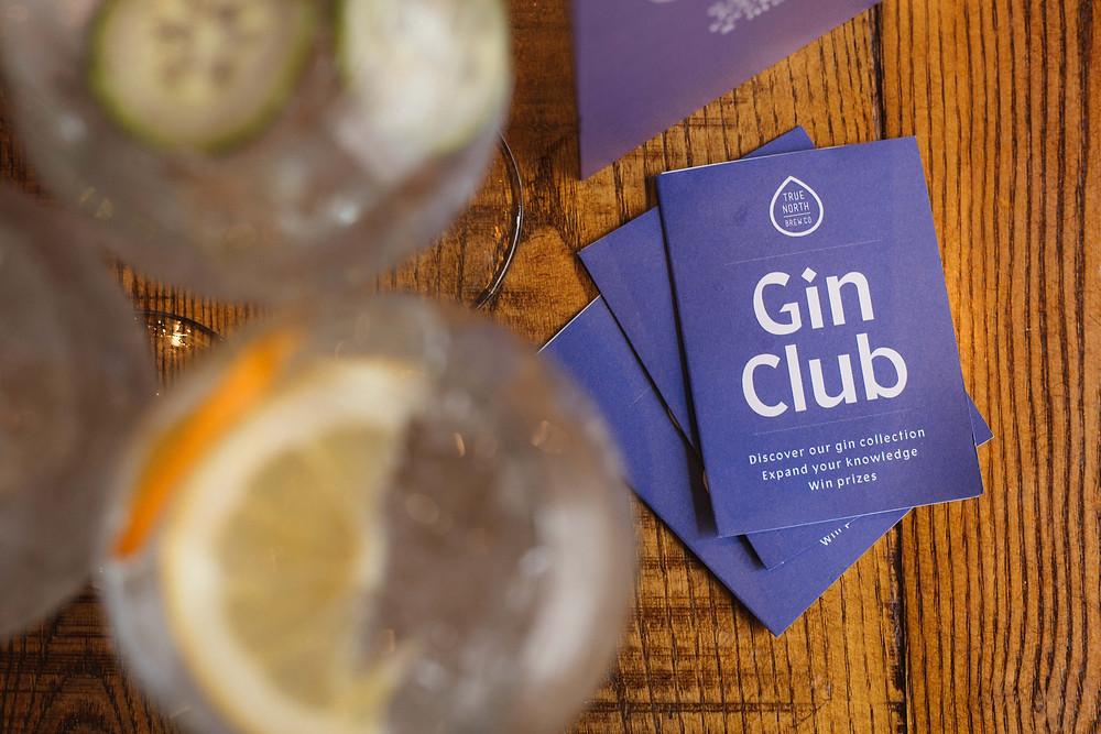 A photo of True North Bew Co's Gin Club booklet.