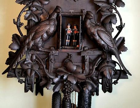 black forest clock, black forest clocks, cuckoo clock, trumpeter clock, flute clock, monk clock. organ clock