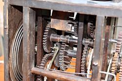 Black Forest wood gear shield clock