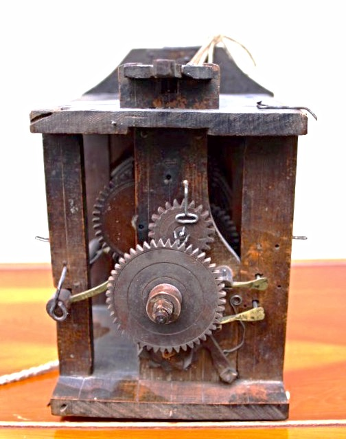 Wood gear shield clock movement