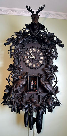 antique black forest clock, black forest clocks, cuckoo clock, trumpeter clock, flute clock, monk clock. organ clock