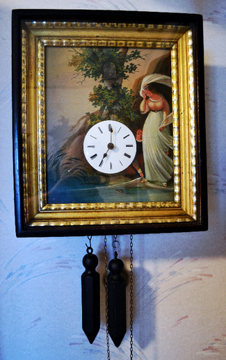 Early wood plate movement cuckoo clock with painting on tin