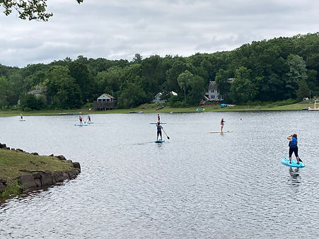 Y Members on Paddleboards at Jobs Pond.