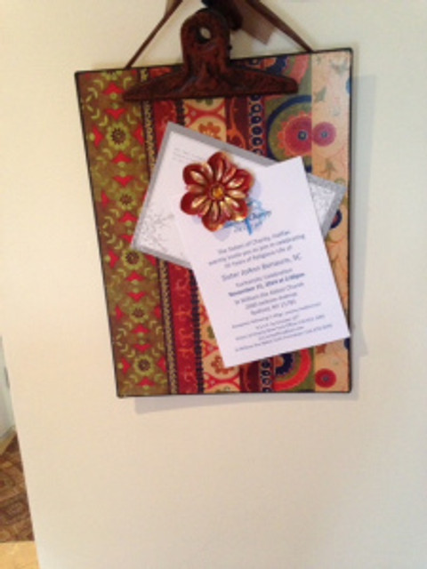 clipboard with invitations