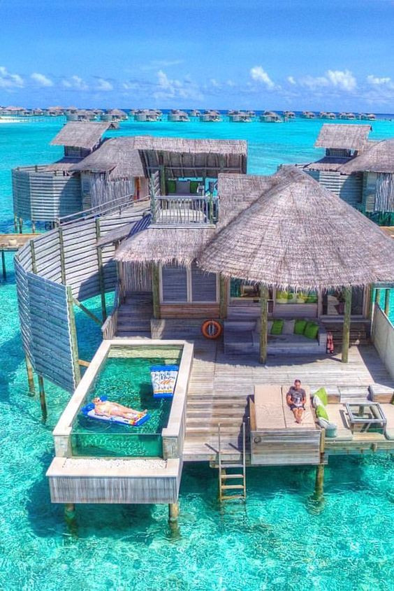 blue ocean with bungalow