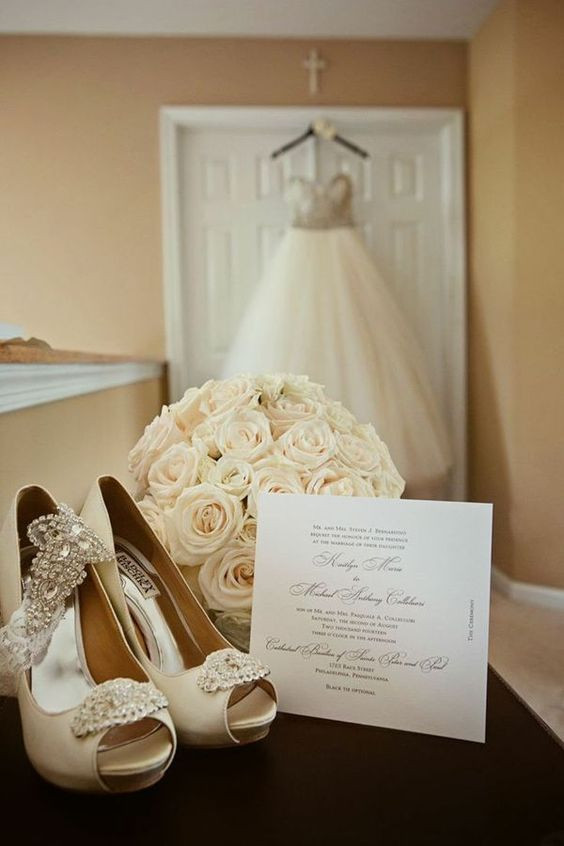 white bride shoes, flowers and dress