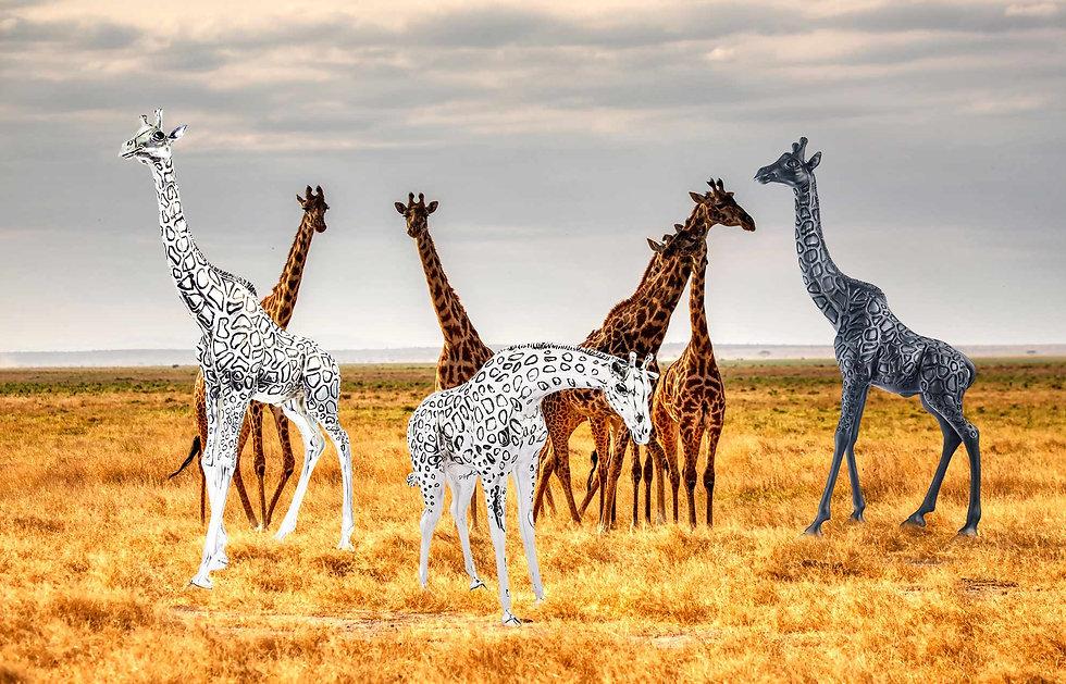 Giraffe Statues image with 2 silver giraffes and a black giraffe statue by D'Argenta and photo bymariola-grobelska.jpg