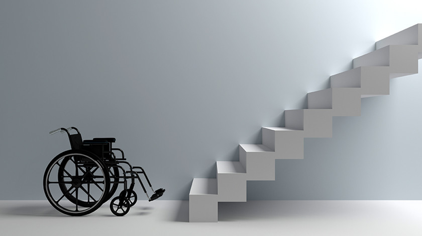 A grey, white and black minimalist image of a wheelchair on the left of the image, in profile, facing a precipitous stairway which leads up and out of the frame.