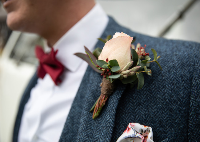Dusky-pink-rose-buttonhole-blue-suit.jpg