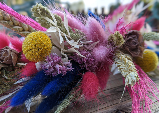Vibrant-dried-flower-crown-pink-yellow-blue-pale-bright-roses.jpg
