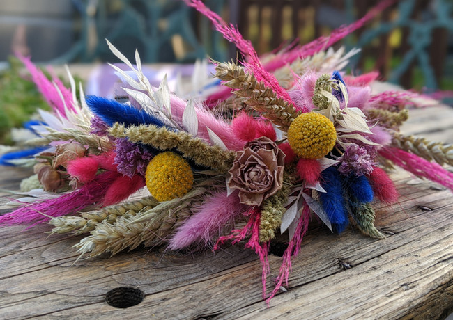 Vibrant-dried-flower-crown-pink-blue-yellow-pale-bright-roses-garden.jpg