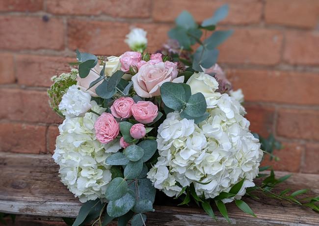 Funeral-tribute-flowers-pastel-pink-white-hydrageas-roses-foliage.jpg
