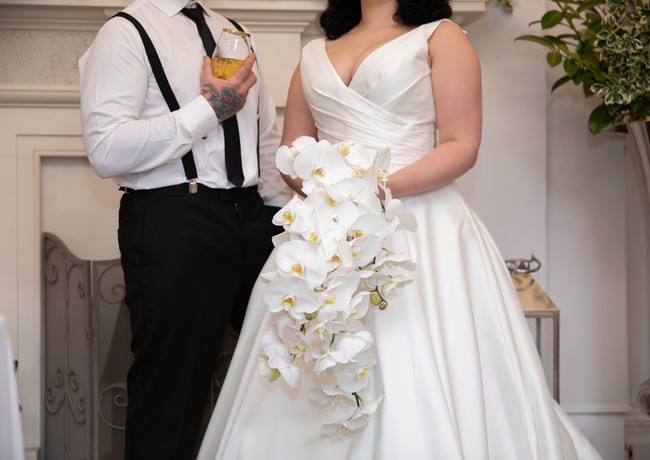 Bride-and-groom-white-orchid-bridal-bouq