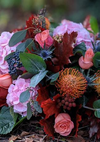 Funeral-tribute-flowers-autumnal-vibrant-hydrageas-roses-foliage.jpg