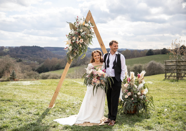 Countryside-wedding-setup-wooden-triangl