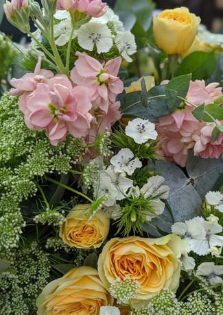 Funeral-tribute-flowers-pastel-yellow-pink-white-stocks-roses-foliage.jpg