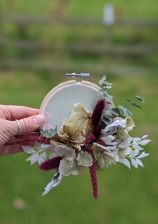 Dried-flower-hoop-art-hydrangea-red-roses-amaranthus-eucalyptus-ruscus-green-grass.jpg