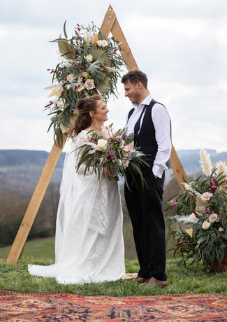 Bride-and-groom-vows-triangle-archway-ou