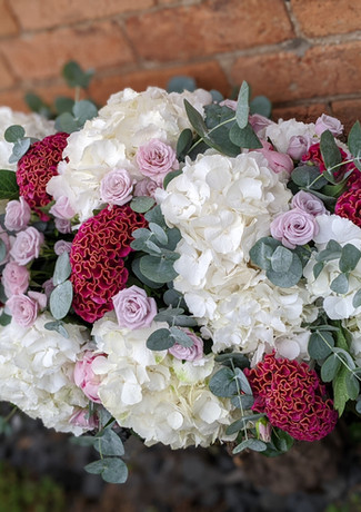 Funeral-tribute-flowers-pastel-bright-palepink-white-celosia-roses-foliage.jpg