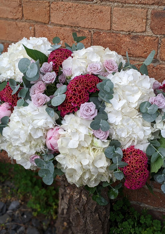 Funeral-tribute-flowers-pastel-bright-pink-white-celosia-roses-foliage.jpg
