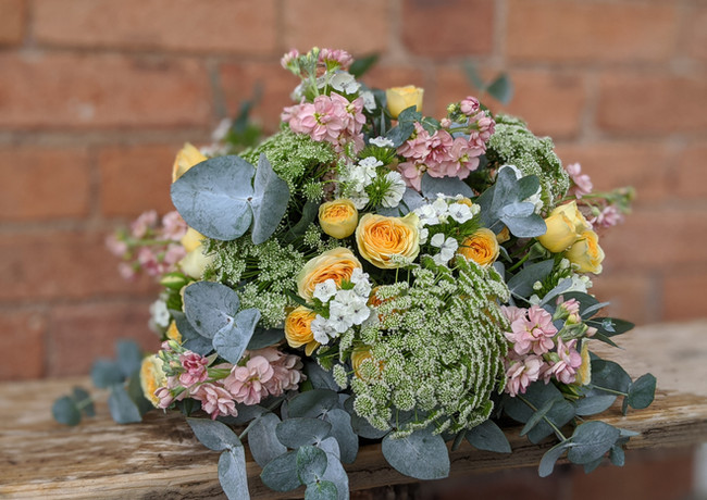 Funeral-tribute-flowers-pastel-bright-yellow-pink-white-ammi-stocks-roses-foliage.jpg
