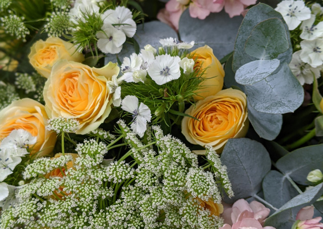 Funeral-tribute-flowers-pastel-yellow-pink-white-ammi-stocks-roses-foliage.jpg