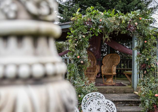 Foliage-rose-archway-band-stand-wedding-